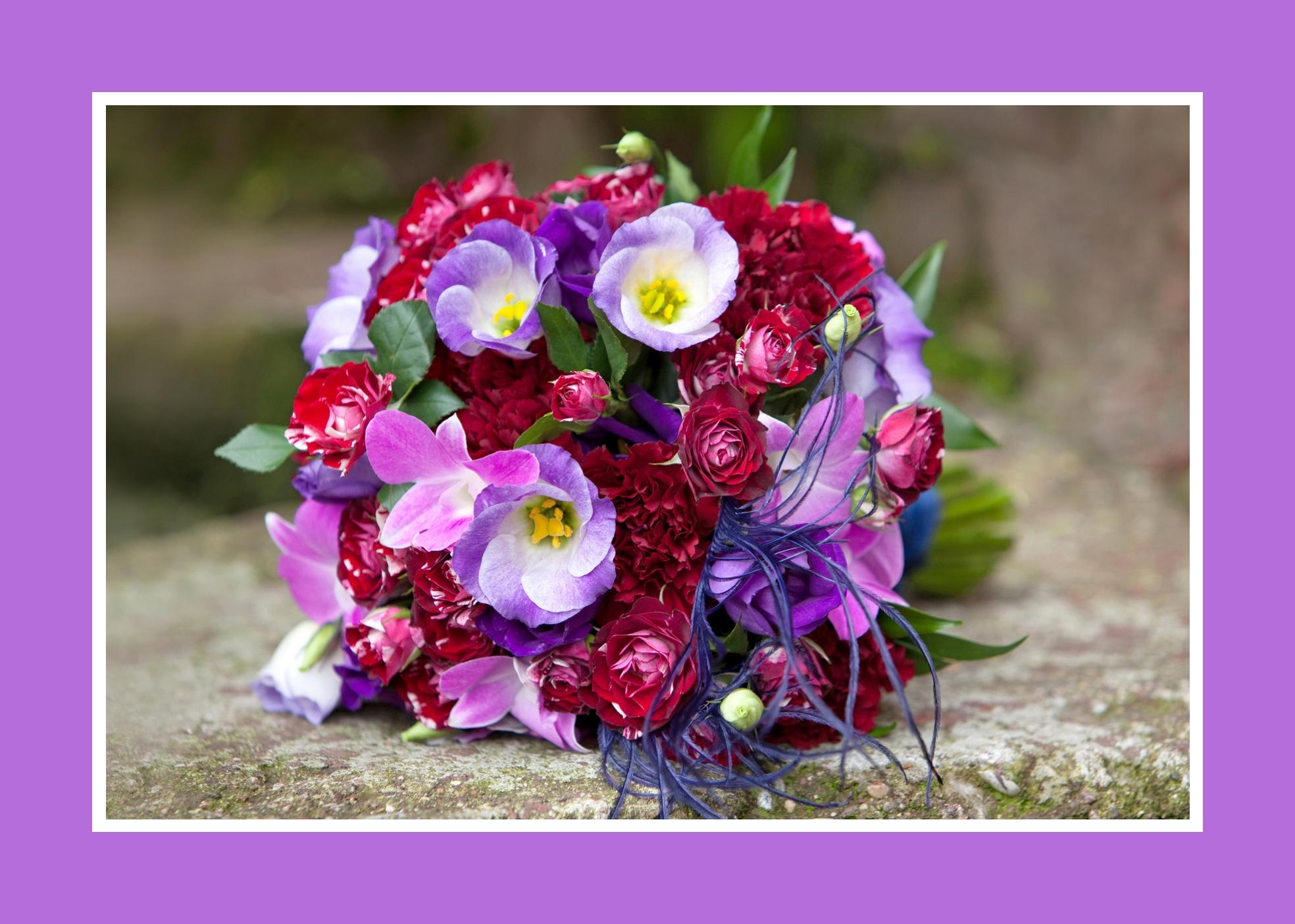 Brautstrauß aus Nelken, Orchideen, Ranunkeln
